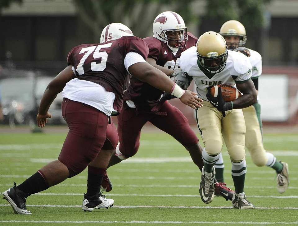 Bay Shore's #75 moves in to stop Longwood's