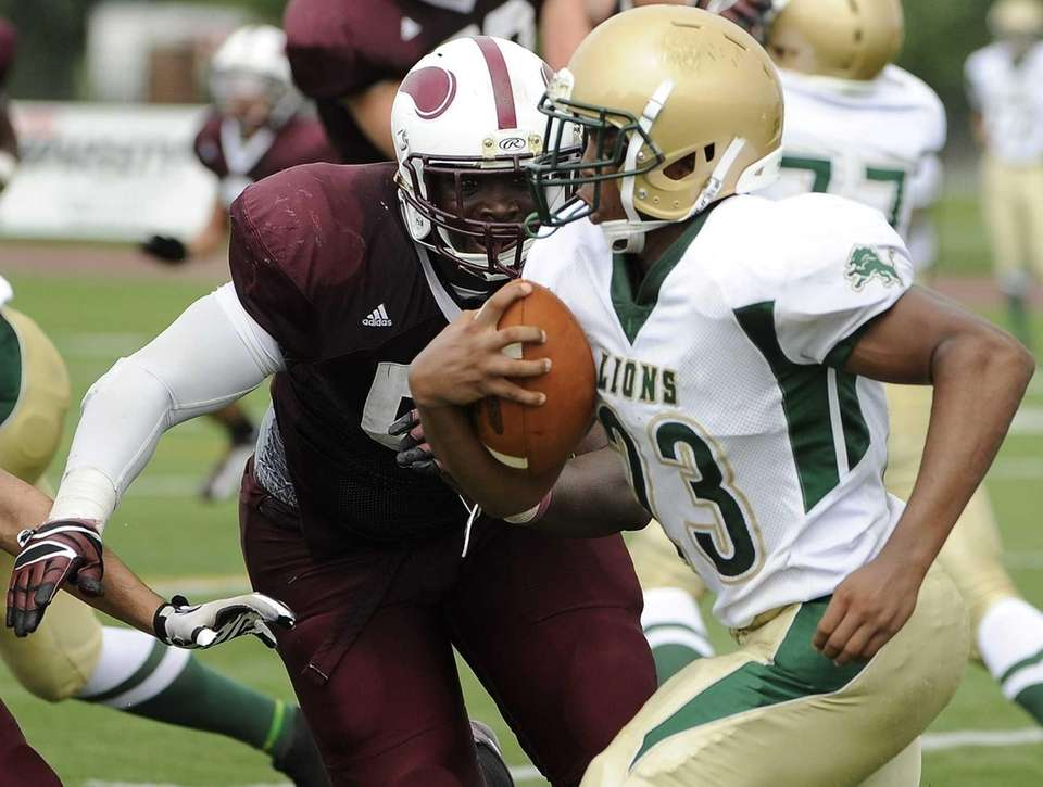 Bay Shore's Ousmane Camara moves in to stop