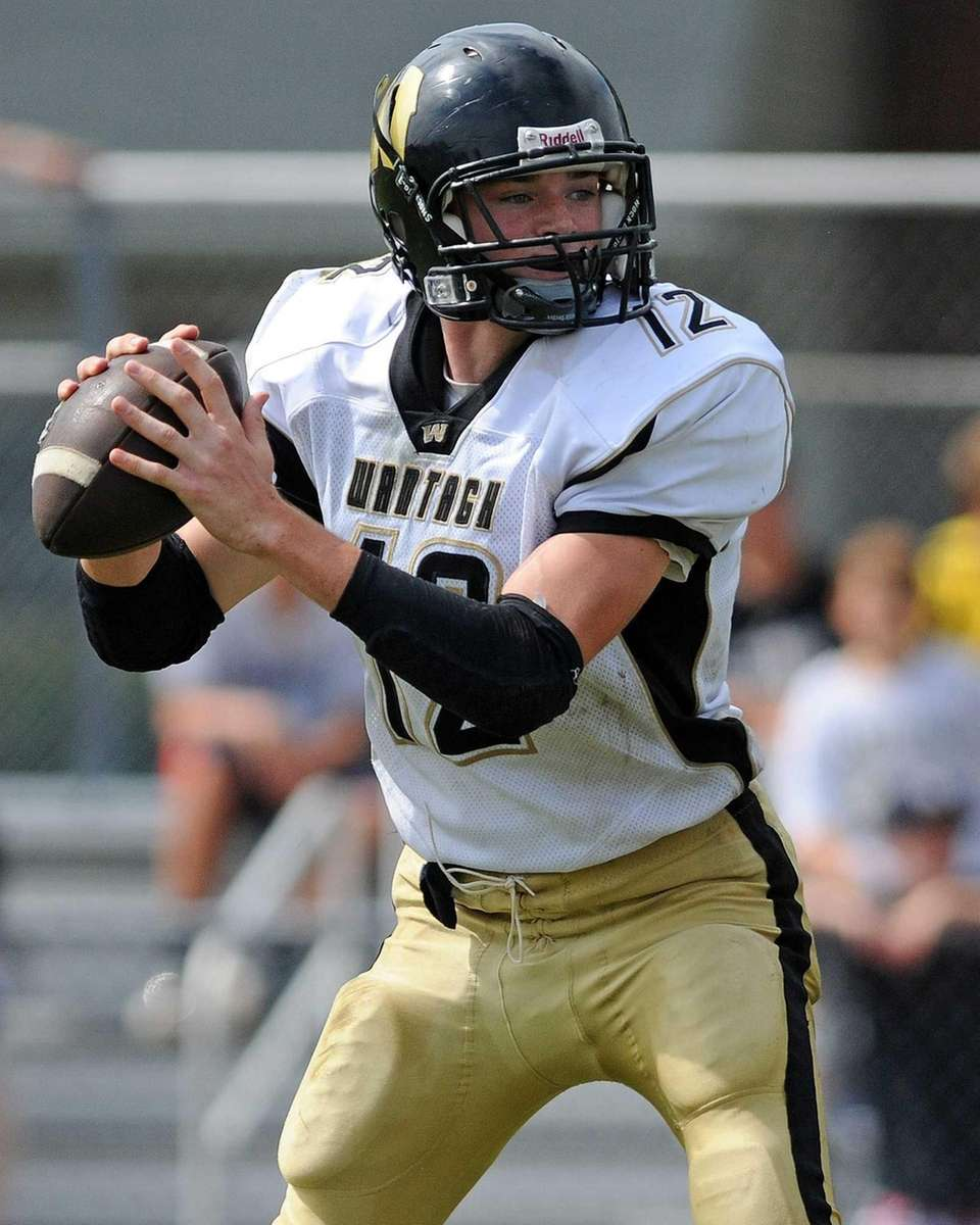 Wantagh High School quarterback #12 Roddy Roche looks