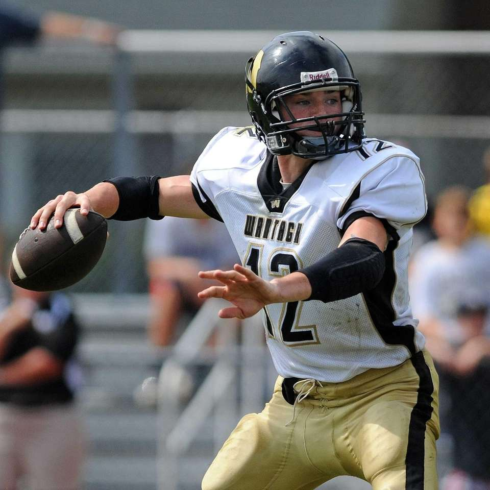 Wantagh High School quarterback #12 Roddy Roche throws