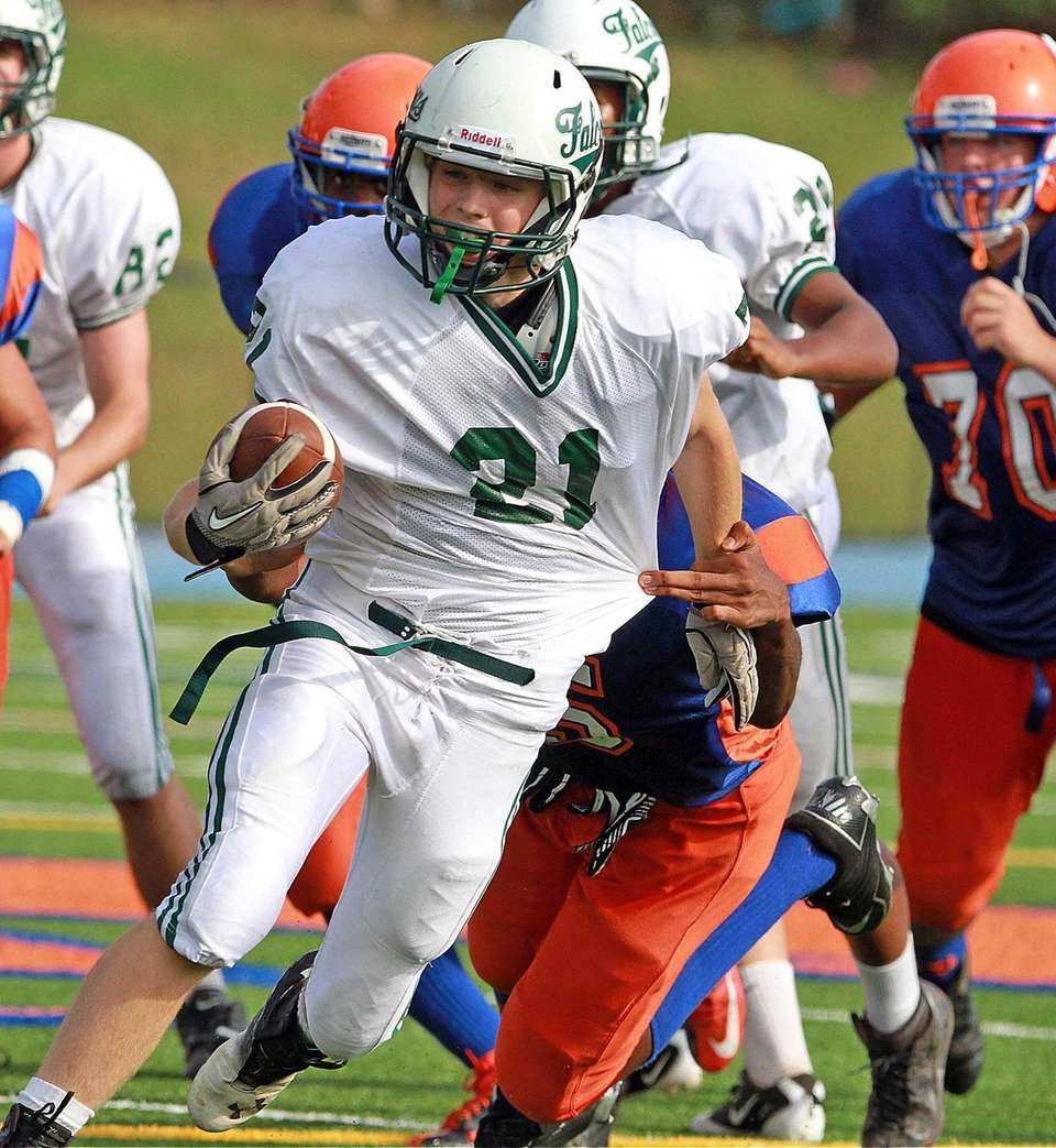 Locust Valley's Louis Jokinsky breaks a few tackles