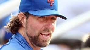 R.A. Dickey looks on during a game against