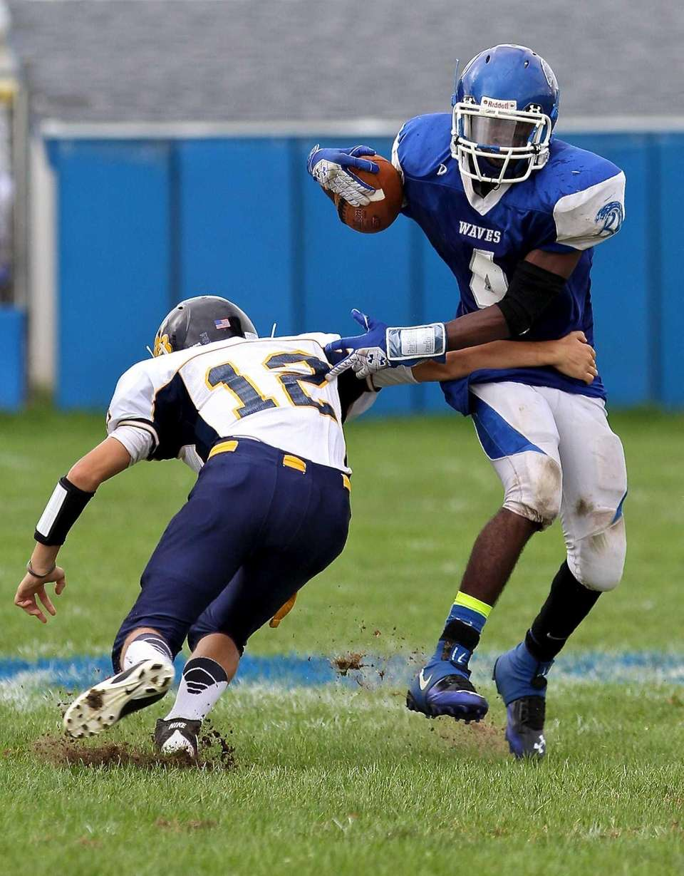 Riverhead TE Andrew Kinard #4, sidesteps the hit