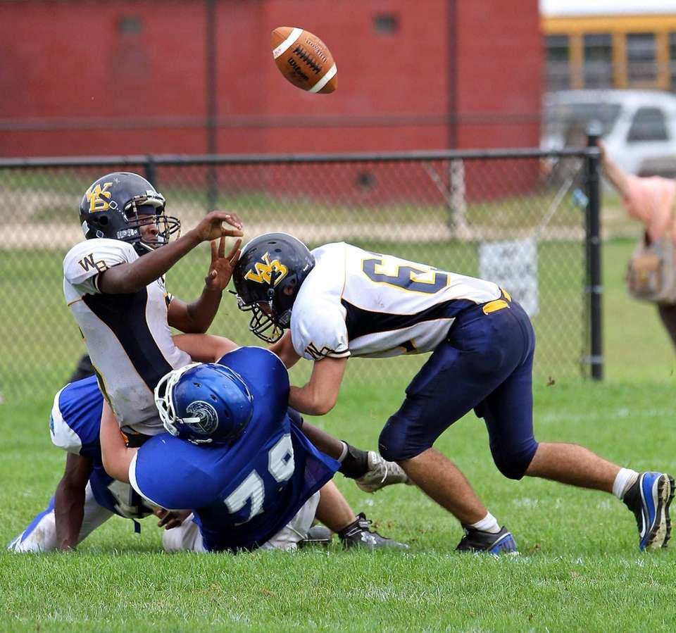 West Babylon QB Clifton Melhado #5 tries to