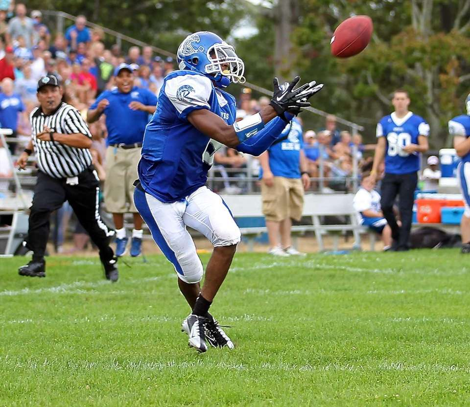 Riverhead WR Quinn Funn #8 looks to grab