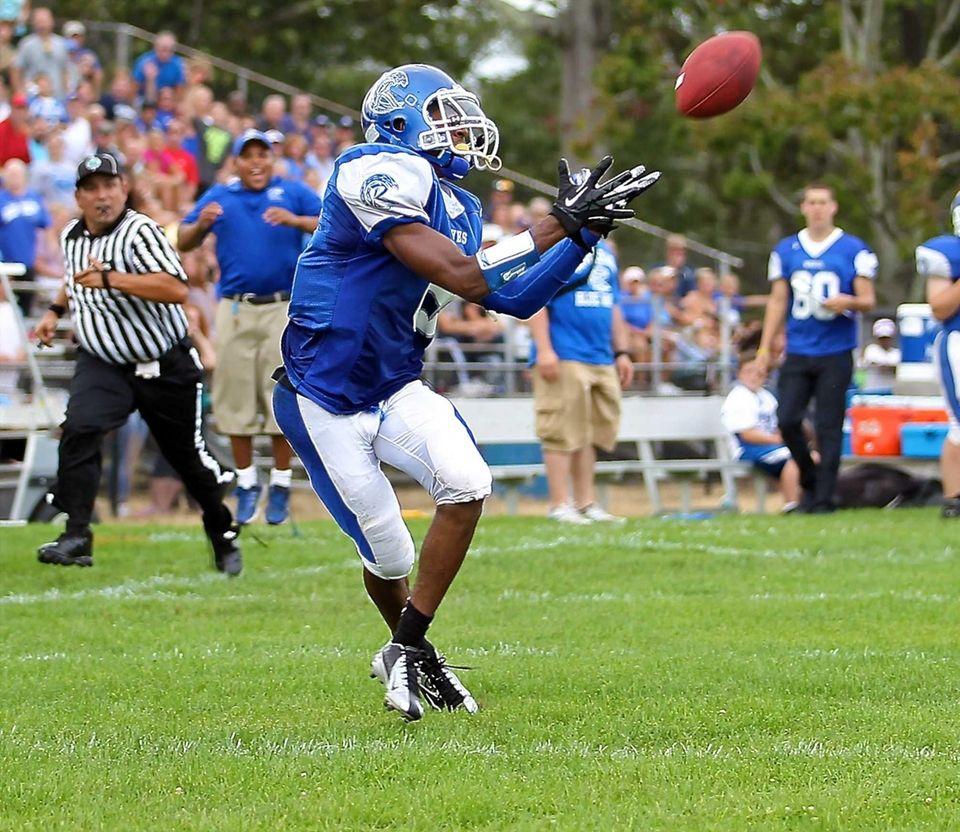 Riverhead WR Quinn Funn #8 looks to grab