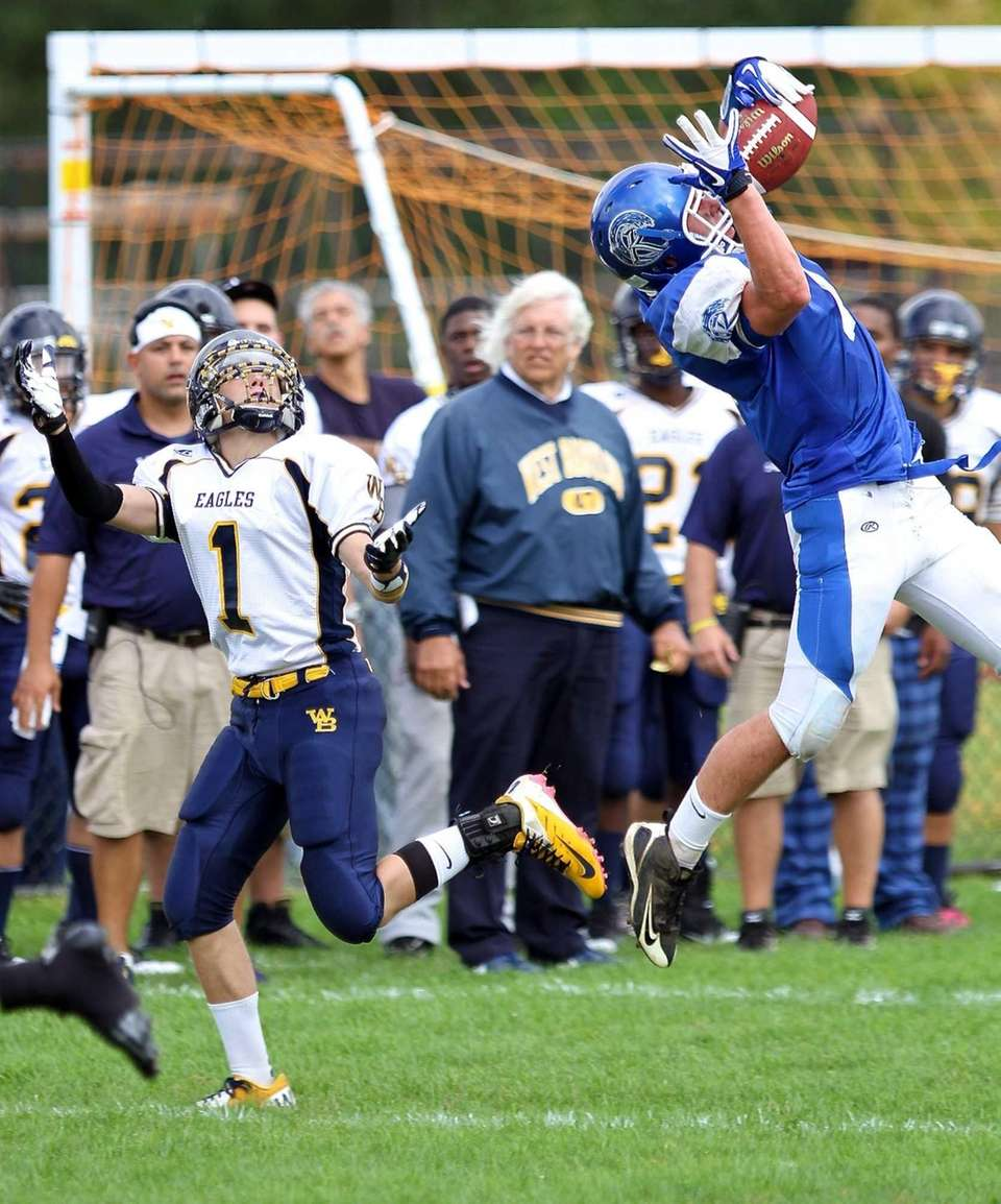 Riverhead LB Matthew Hejmej #7 intercepts the pass