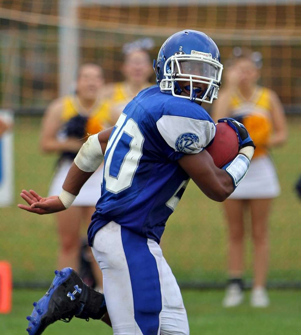 Riverhead RB Jeremiah Cheatom #20 looks behind him