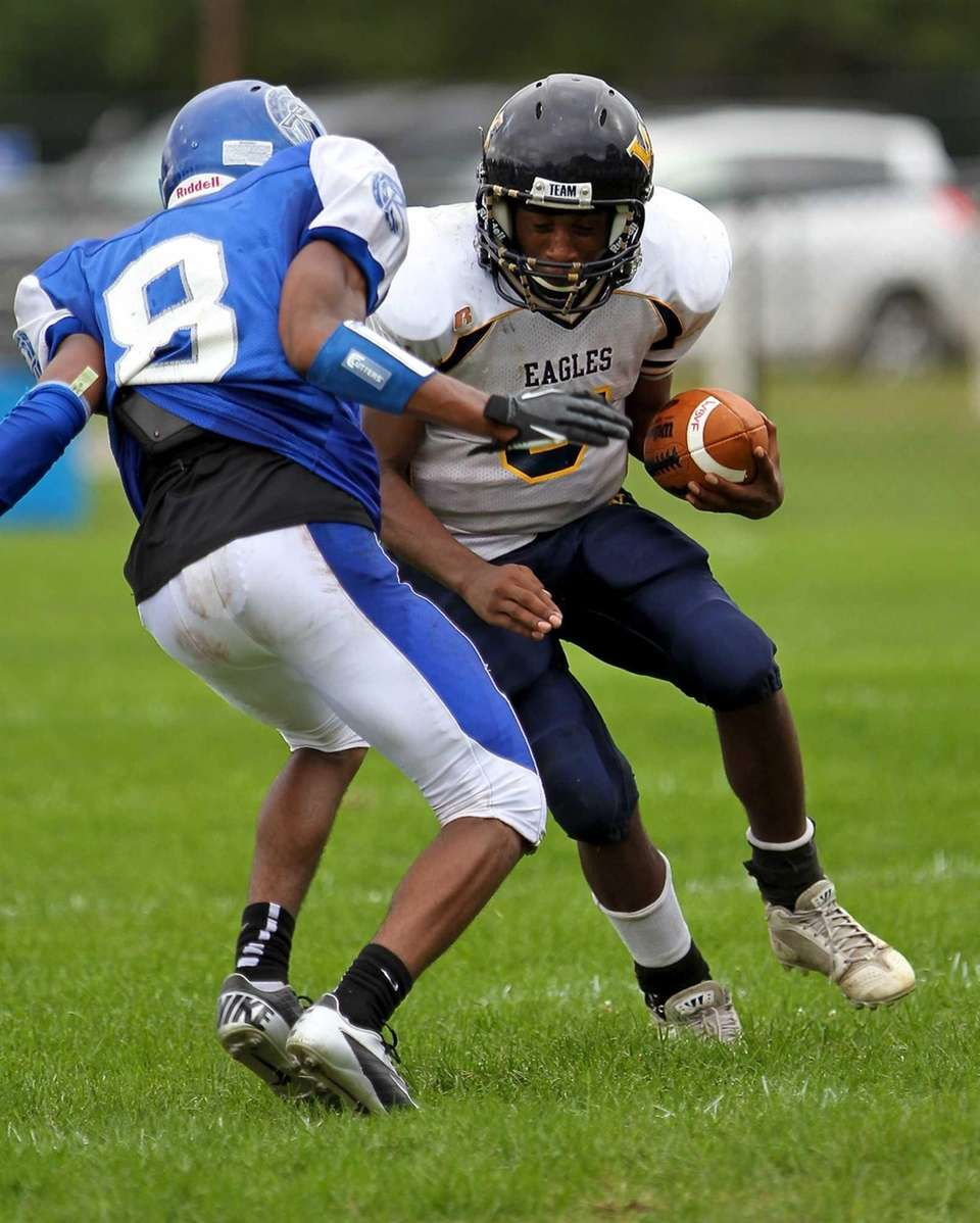 A Riverhead DB prepares to make the tackle