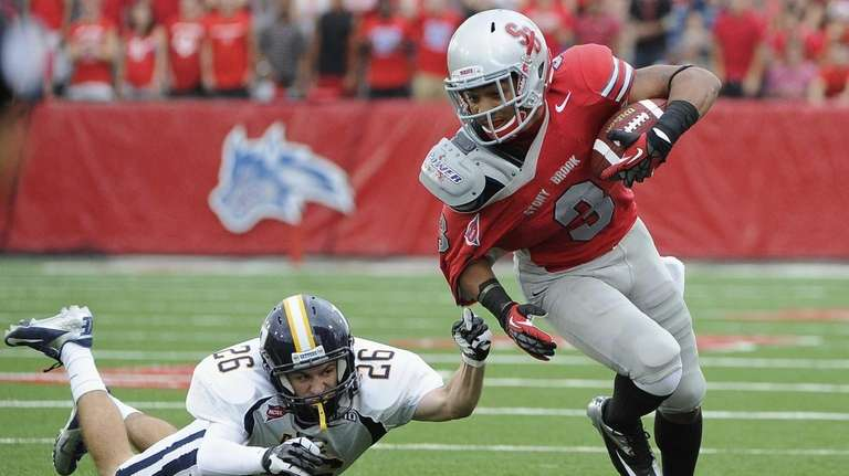 Stony Brook's Kevin Norrell evades a tackle by