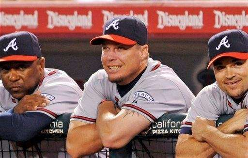 From left, Atlanta Braves' Terry Pendleton, Chipper Jones