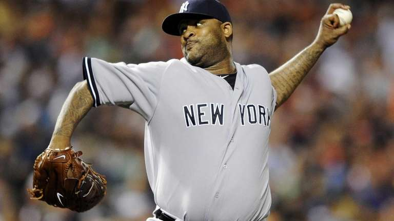 CC Sabathia delivers a pitch in a game