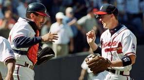 Atlanta Braves third baseman Chipper Jones, right, celebrates