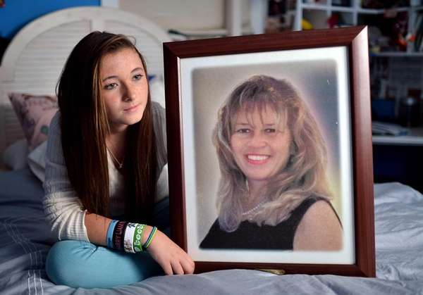 Patricia Smith, now 13, shows a photo of