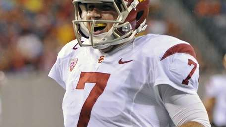 Southern California quarterback Matt Barkley celebrates after throwing