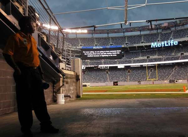 A security guard stands in the tunnel as