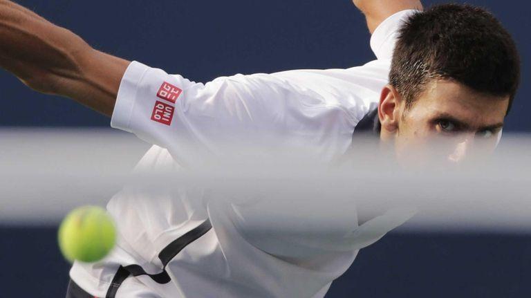 Serbia' Novak Djokovic returns a shot to Spain's