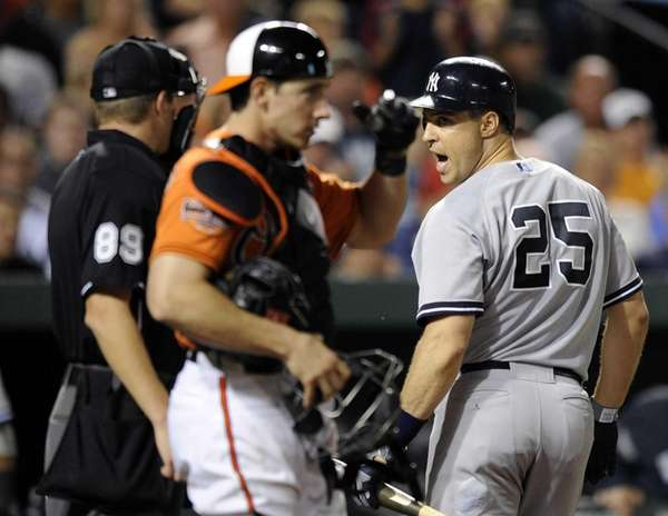 New York Yankees' Mark Teixeira (25) talks with