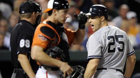 New York Yankees' Mark Teixeira (25) talks with