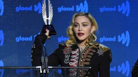 Honoree Madonna accepts the advocate for change award