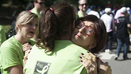 Woodmere resident Andrea Koster-Crain, a cancer survivor, receives