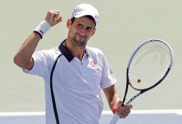 Serbia's Novak Djokovic reacts after beating Spain's David
