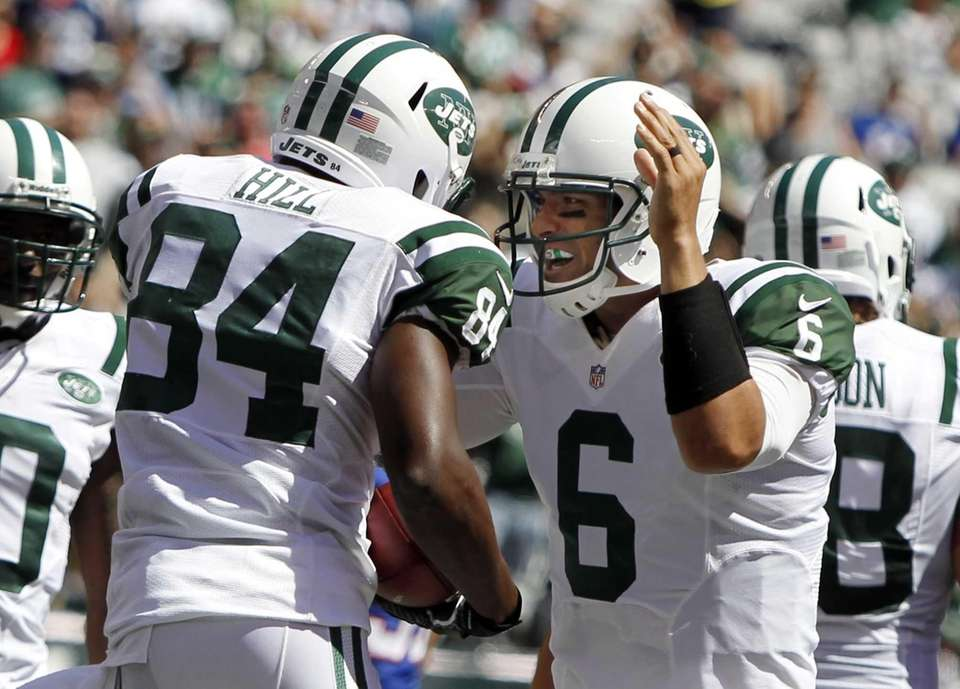 New York Jets quarterback Mark Sanchez celebrates with