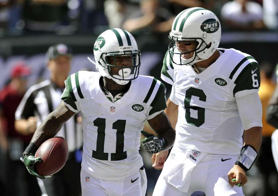 New York Jets quarterback Mark Sanchez (6) and