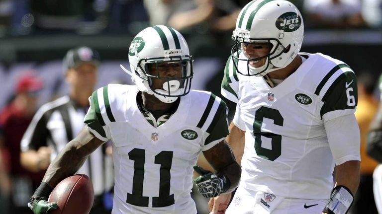 New York Jets quarterback Mark Sanchez (6) and
