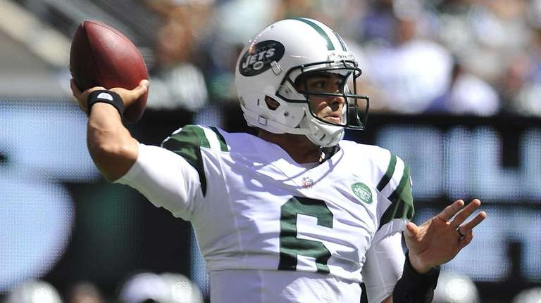 Mark Sanchez sets up to pass against the