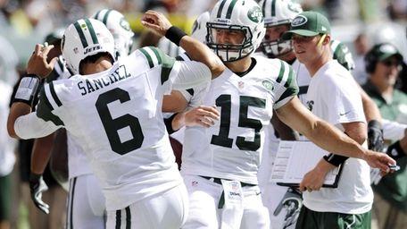 New York Jets quarterbacks Mark Sanchez, left, and