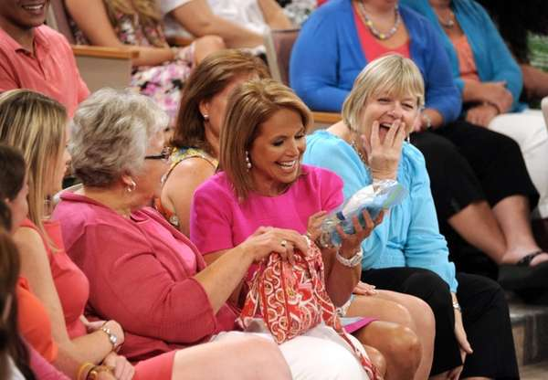 Host Katie Couric sits with audience members during