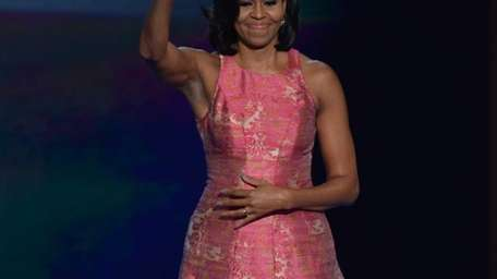 First Lady Michelle Obama acknowledges the crowd after