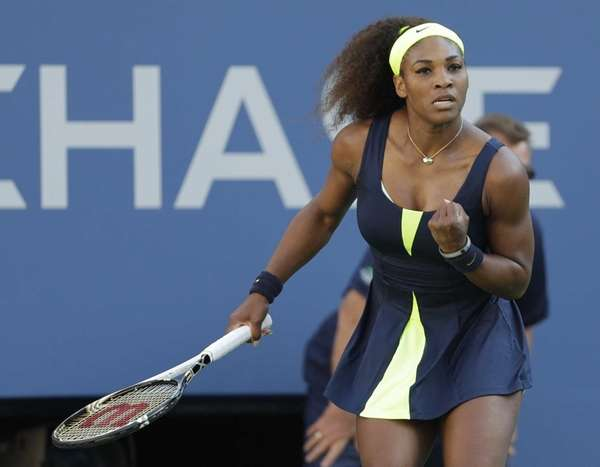 Serena Williams reacts while playing Victoria Azarenka during