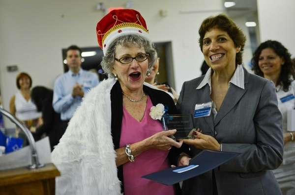 Sondra Rose, left, of Cedarhurst is honored as