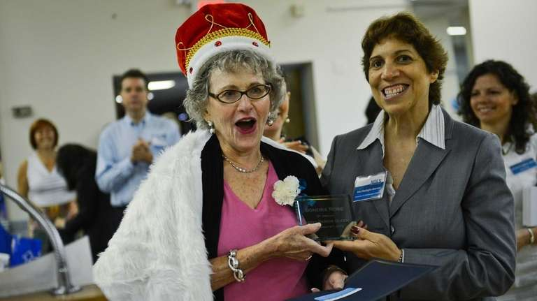 Sondra Rose, left, of Cedarhurst is honored as