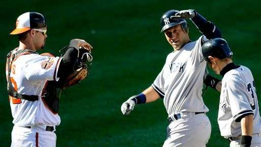 New York Yankees' Derek Jeter, center, celebrates his
