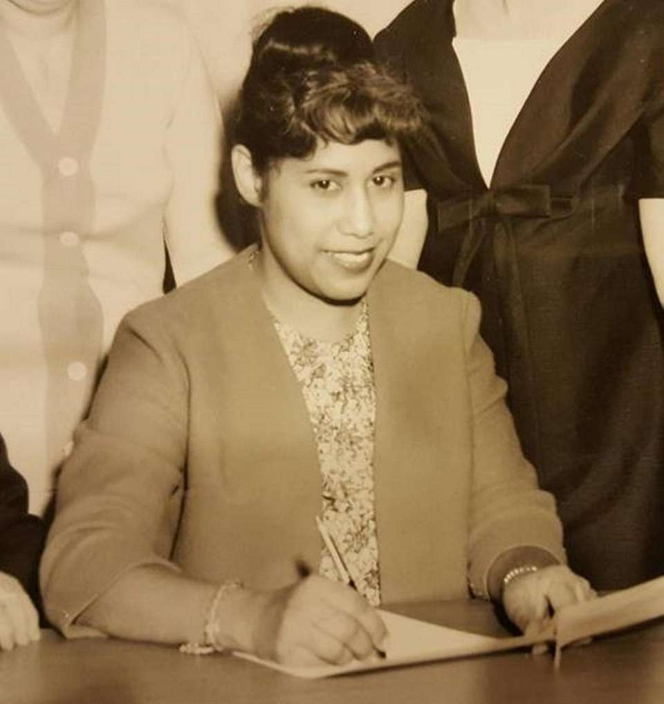 Maria Hartman in 1966 signing papers to launch