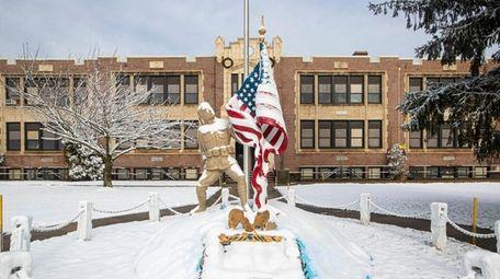 A statue in front of Eastport Elementary School