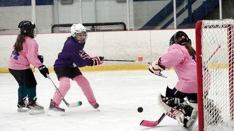 Dix Hills Lightening player Madison McErlean, 12, center,
