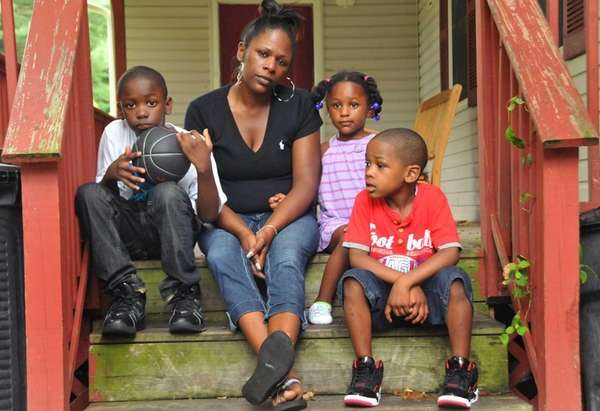 Nicole Patterson, with three of her children (from