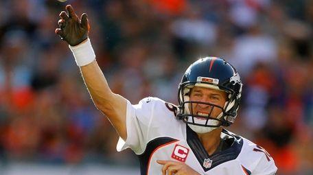 Peyton Manning #18 of the Denver Broncos throws