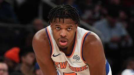 Knicks guard Dennis Smith Jr. looks on against