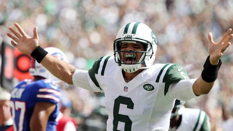 Mark Sanchez celebrates his third touchdown pass of