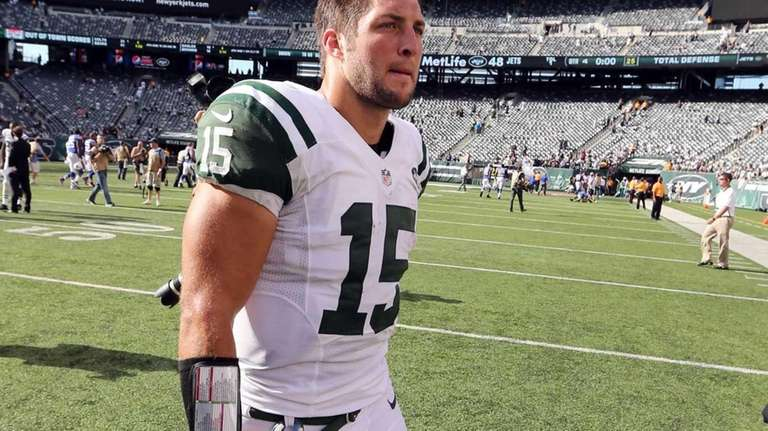 Tim Tebow looks on after a game against