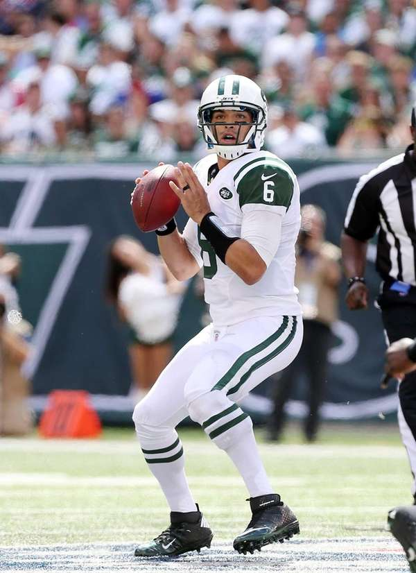 Mark Sanchez looks to throw a pass during