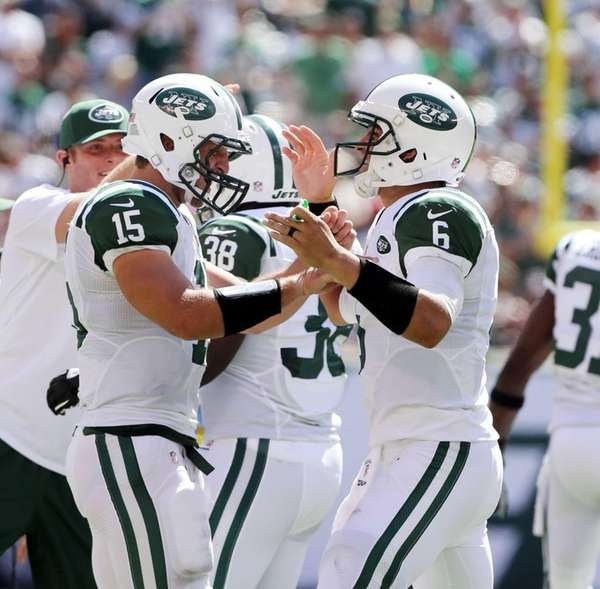 Tim Tebow and Mark Sanchez celebrate after Sanchez