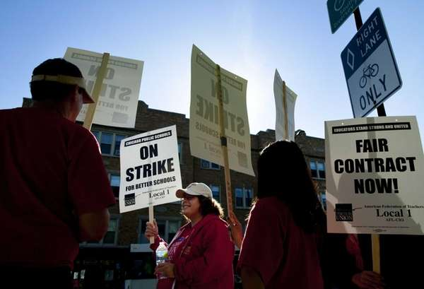 Public school teachers picket outside Amundsen High School
