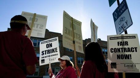 Public school teachers picket outside Amundsen High School