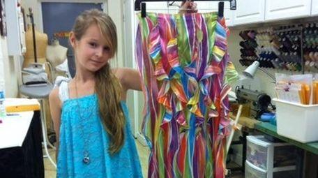 Brielle Caro, 11, of Smithtown, holding the
